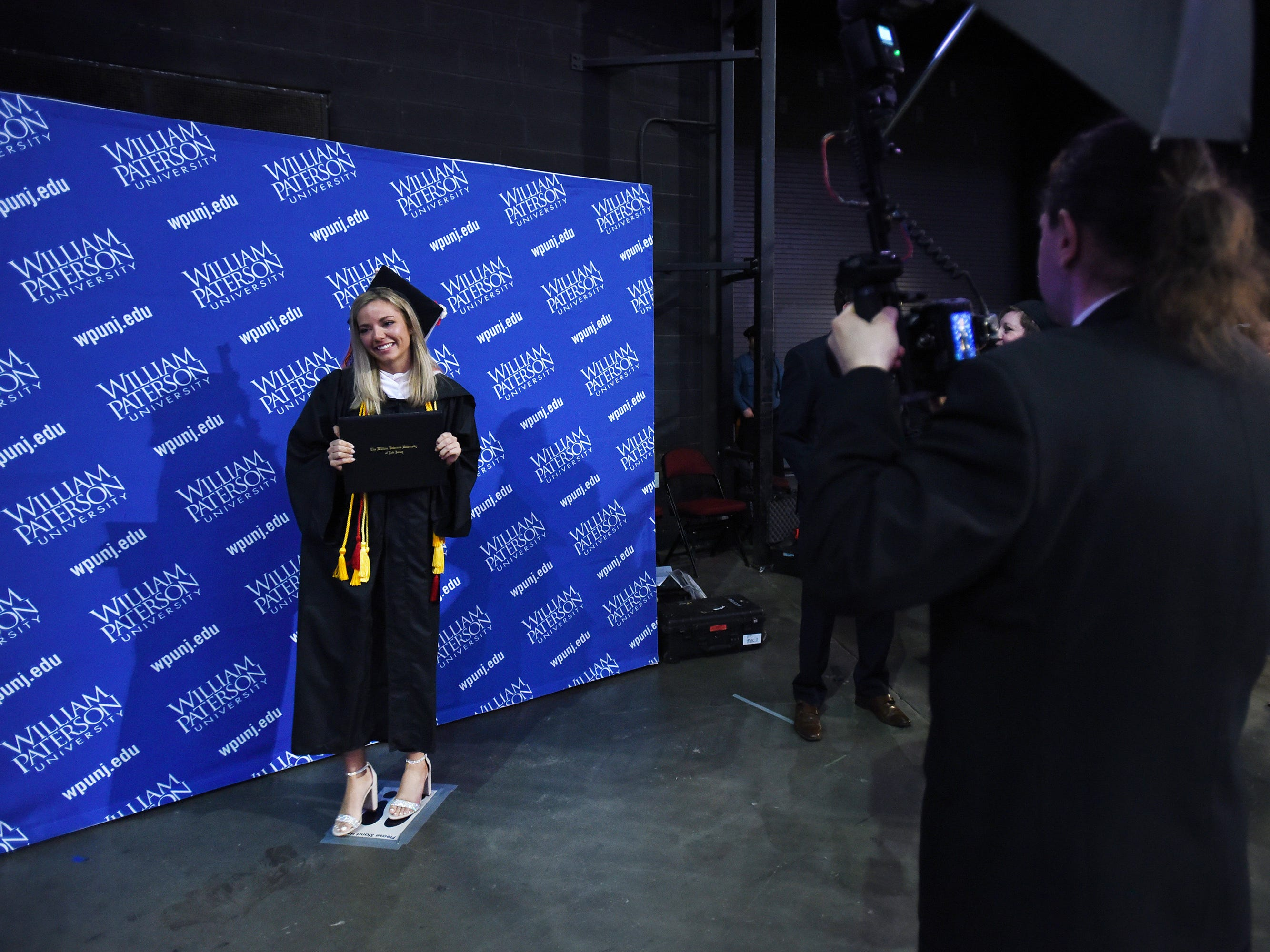 A graduate has her picture taken during the William Paterson University 2019 Commencement at the Prudential Center in Newark on 05/15/19.