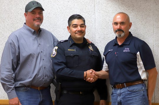 New Deming Police Chief Alex Valdespino (center) is congratulated by Deming Mayor Benny Jasso (right) and City Administrator Aaron Sera at Monday's City Council Meeting.