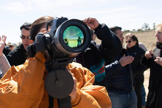 U.S. Rep. Deb Haaland, D-N.M., looks through an infrared camera at oil well emissions near Chaco Canyon.