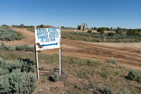 An oil well near the Living Spring Baptist Church in Counselor, New Mexico.