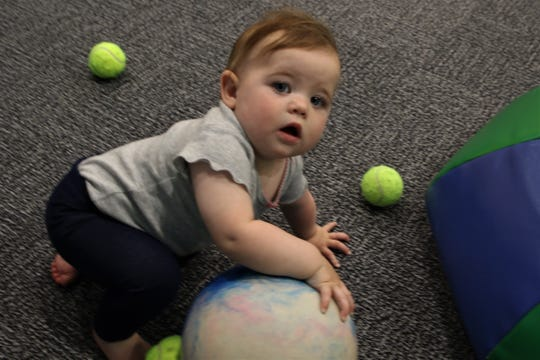 Eight-month-old Cora Margis plays with toys, Wednesday, May 15, 2019, at the E3 Children's Museum and Science Center.