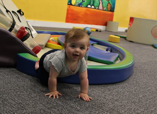 Cora Margis crawls out of a play structure, Wednesday, May 15, 2019, at the E3 Children's Museum and Science Center.