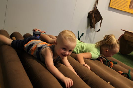 Hudson Allenbaugh, 2, and Hadley Allenbaugh, 5, play, Wednesday, May 15, 2019, at the E3 Children's Museum and Science Center.