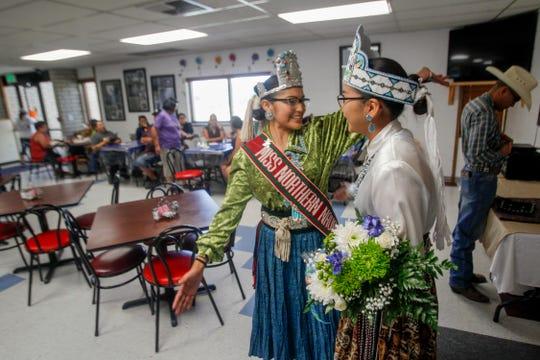 Miss Northern Navajo Ariana Youn, left, reaches out to hug Farmington American Indian Ambassador Nikeisha Sequeoia Kee, Thursday, June 28, 2018 at the Farmington Indian Center.