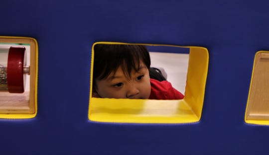 Zoku Soriano, 2, plays, Wednesday, May 15, 2019, at the E3 Children's Museum and Science Center in Farmington.