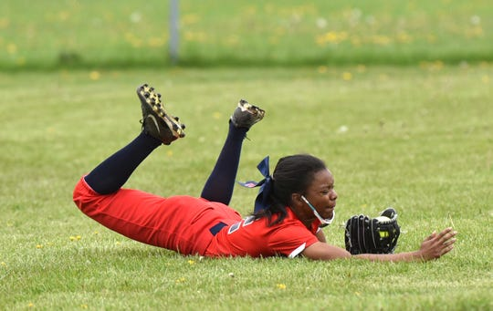Westland John Glenn center fielder Lea Kennedy makes a diving-sliding catch on May 15 at Livonia Stevenson.