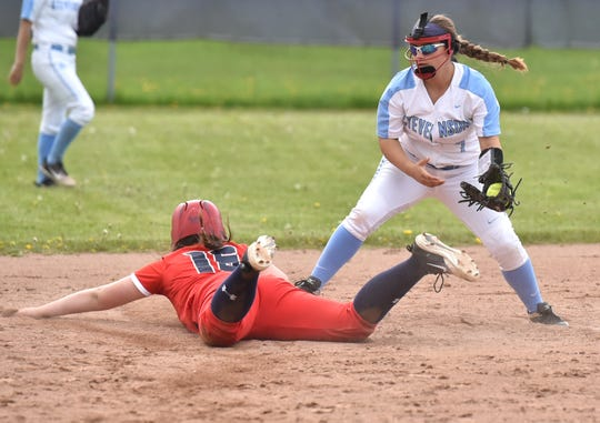 Spartan Alexis Black tries to but can't tag John Glenn's Adin Maxson before she gets back to second base.