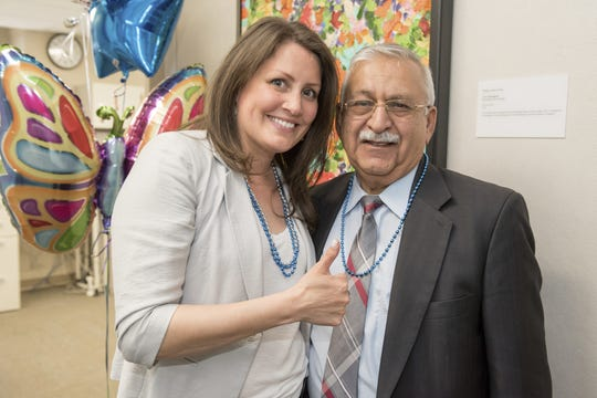 Sasha Archer of Bloomfield Hills celebrates her 10-year survival of glioblastoma with Dr. Ghaus Malik at Henry Ford Hospital in Detroit on May 8, 2019.