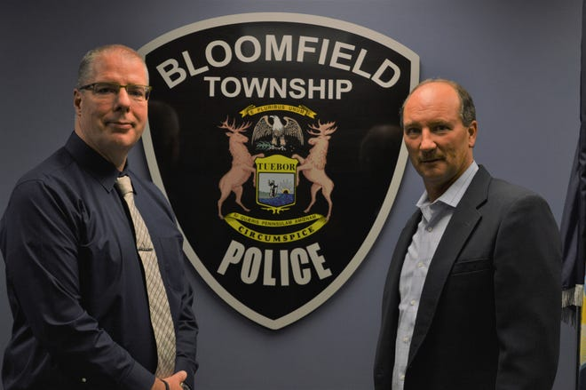 From left to right, new Police Chief Phil Langmeyer and retiring Police Chief Scott McCanham pose for a picture on Wednesday, May 15, 2019.