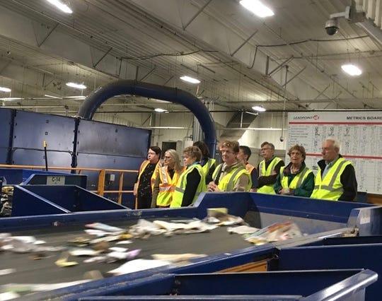 SOCRRA visitors watch the conplex conveyer belt sorting process.