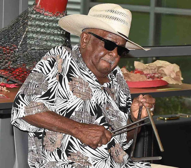 Opelousas resident Joe Citizen sits in with Jeffery Broussard at Saturday's Zydeco Jam at the St. Landry Parsih Tourist and Information Center.