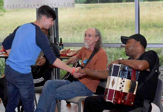 Jeffery Broussard, right, zydeco great, welomes musicians who joined him on Saturday for a jam session at the St. Landry Parish Tourist and Information Center.