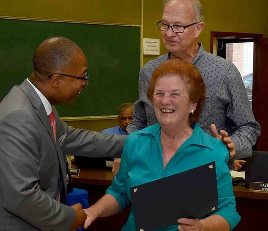 Judy Credeur receives congratulations from St. Landry Parish School Superintendent Patrick Jenkins and school board member, Donnie Perron, after receiving her certificate as outstanding teacher's aide at Port Barre HJigh School. Credeur will be retiring after 30 plus years of dedicated service.