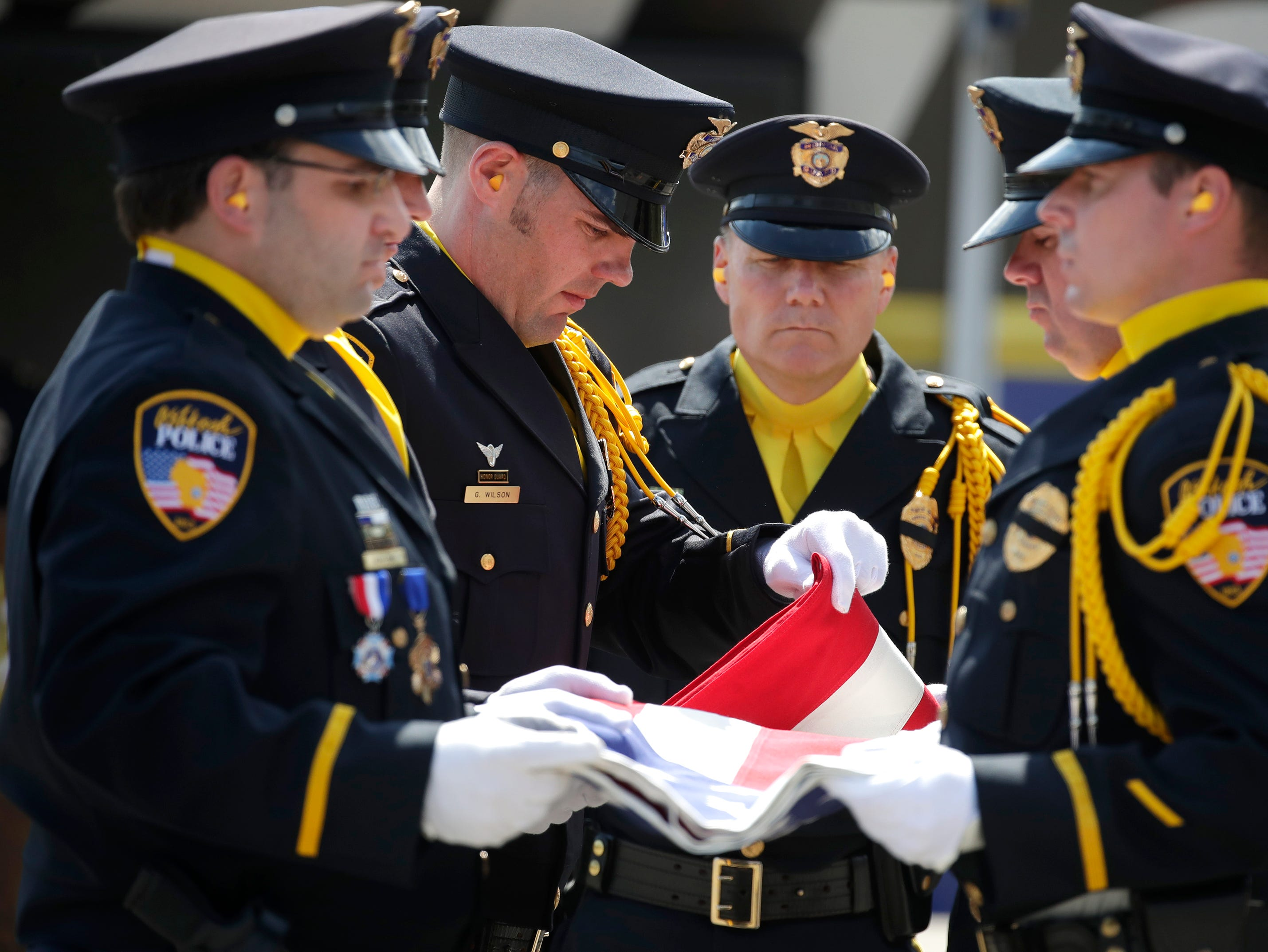 The Oshkosh Police Department Honor Guard folds the flag during their Law Enforcement Memorial Ceremony Wednesday, May 15, 2019, at the Oshkosh Police Department in Oshkosh, Wis. Danny Damiani/USA TODAY NETWORK-Wisconsin