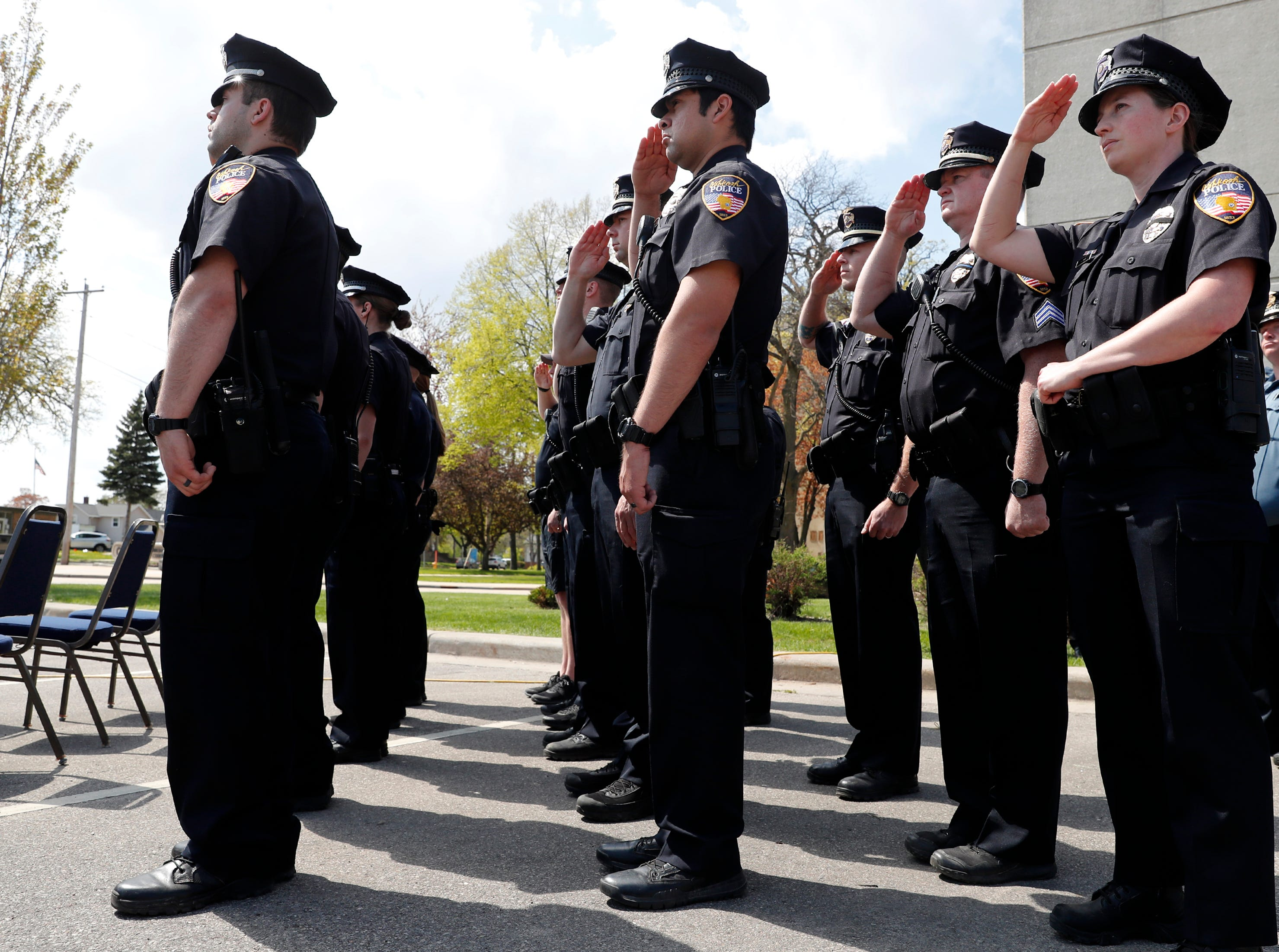 Oshkosh police officers salute during the playing of Taps at their Law Enforcement Memorial Ceremony Wednesday, May 15, 2019, at the Oshkosh Police Department in Oshkosh, Wis. Danny Damiani/USA TODAY NETWORK-Wisconsin