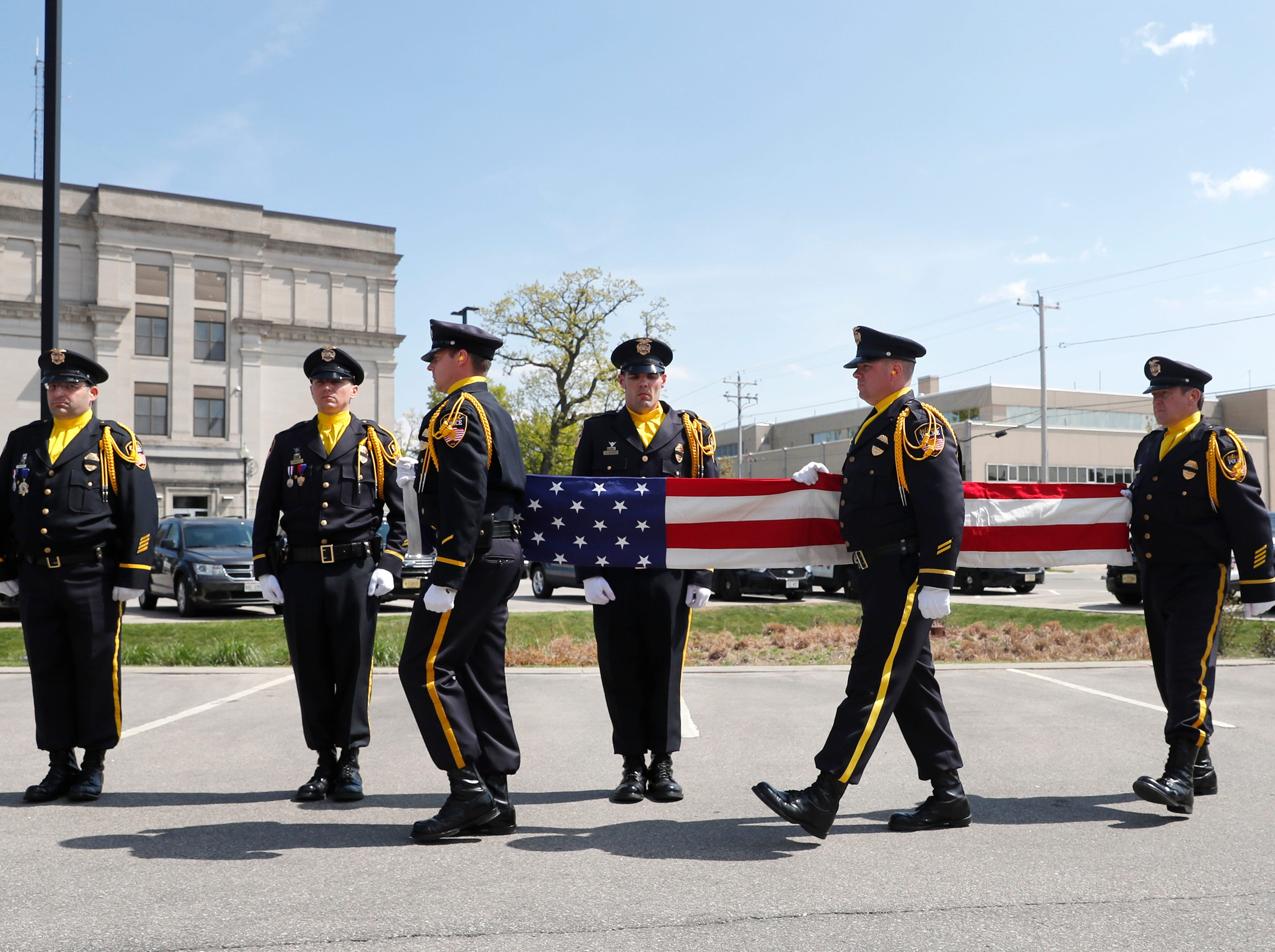 The Oshkosh Police Honor Guard prepares for the folding of the flag during their Law Enforcement Memorial Ceremony Wednesday, May 15, 2019, at the Oshkosh Police Department in Oshkosh, Wis. Danny Damiani/USA TODAY NETWORK-Wisconsin