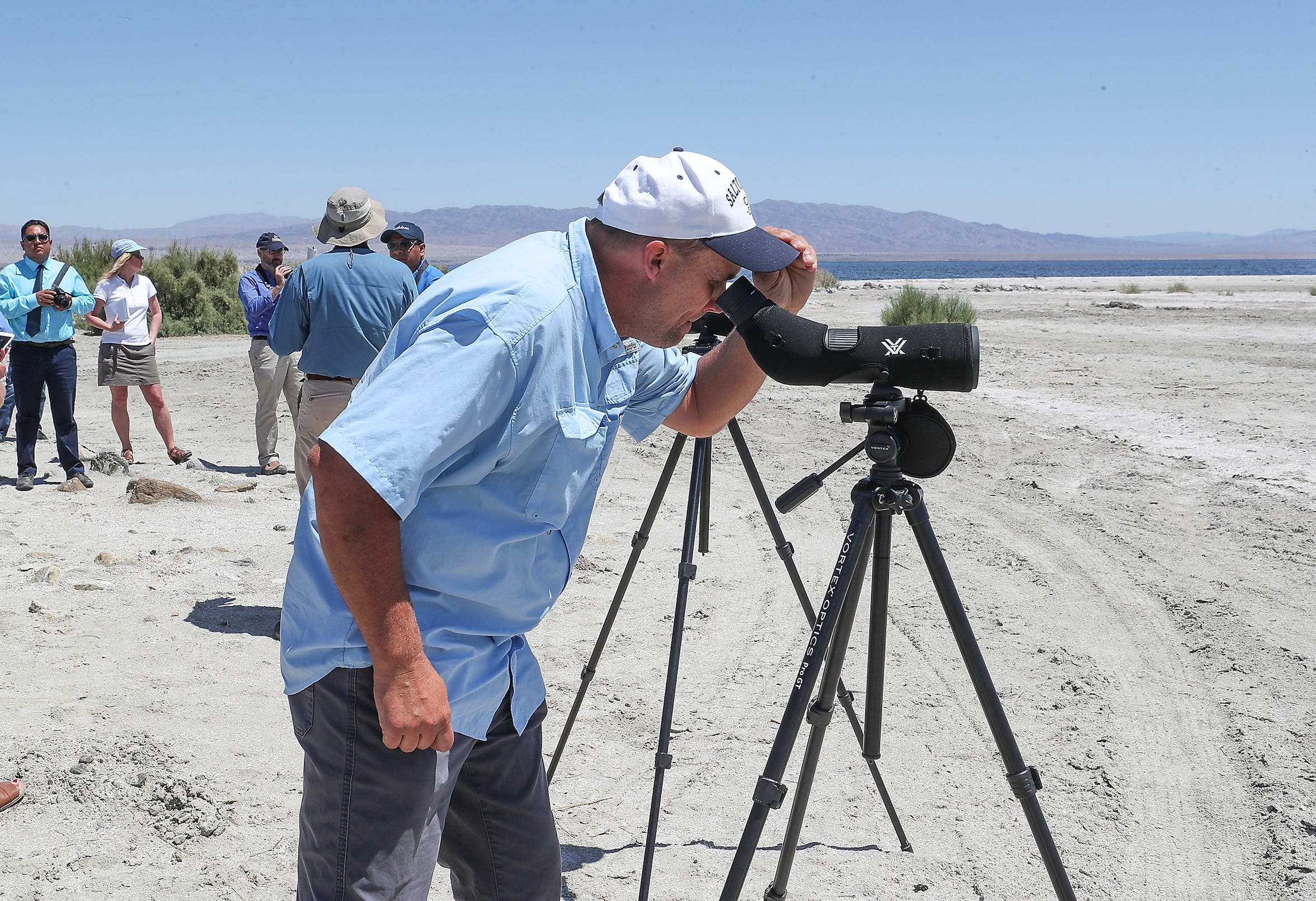Kurt Leushner, professor of Natural Resources at College of the Desert, looks at birds through at the Salton Sea, April 30, 2019.