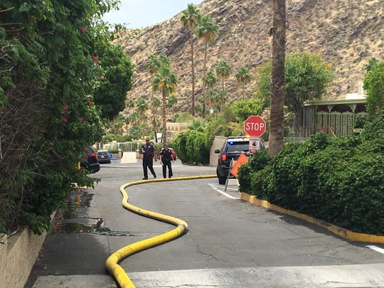 Palm Springs firefighters run a fire hose through a mobile-home park where a fired erupted Wednesday morning. It was extinguished quickly with no injuries.