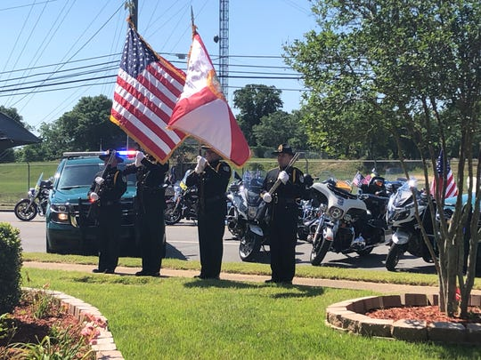 The Escambia County Sheriff's Office honor guard presents the colors Wednesday at a law enforcement memorial ceremony.