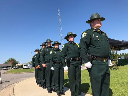 Deputies with the Santa Rosa County Sheriff's Office pay tribute to deputies killed in the line of duty during a ceremony Wednesday.