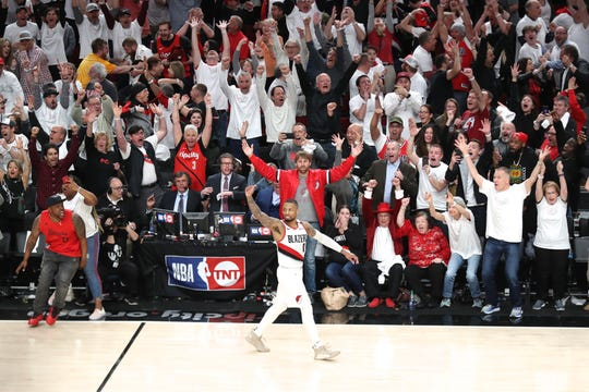 Apr 23, 2019; Portland, OR, USA; Portland Trail Blazers guard Damian Lillard (0) reacts after making a three-point shot over Oklahoma City Thunder forward Paul George (13) to defeat Oklahoma City Thunder 118-115 in game five of the first round of the 2019 NBA Playoffs at Moda Center. Mandatory Credit: Jaime Valdez-USA TODAY Sports