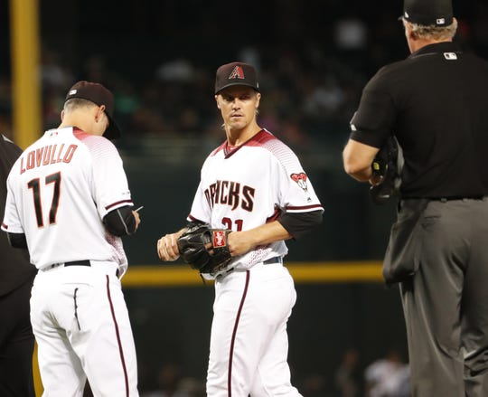 Diamondbacks pitcher Zack Greinke leaves a game against the Pirates in the eighth inning after suffering an apparent injury on May 15.