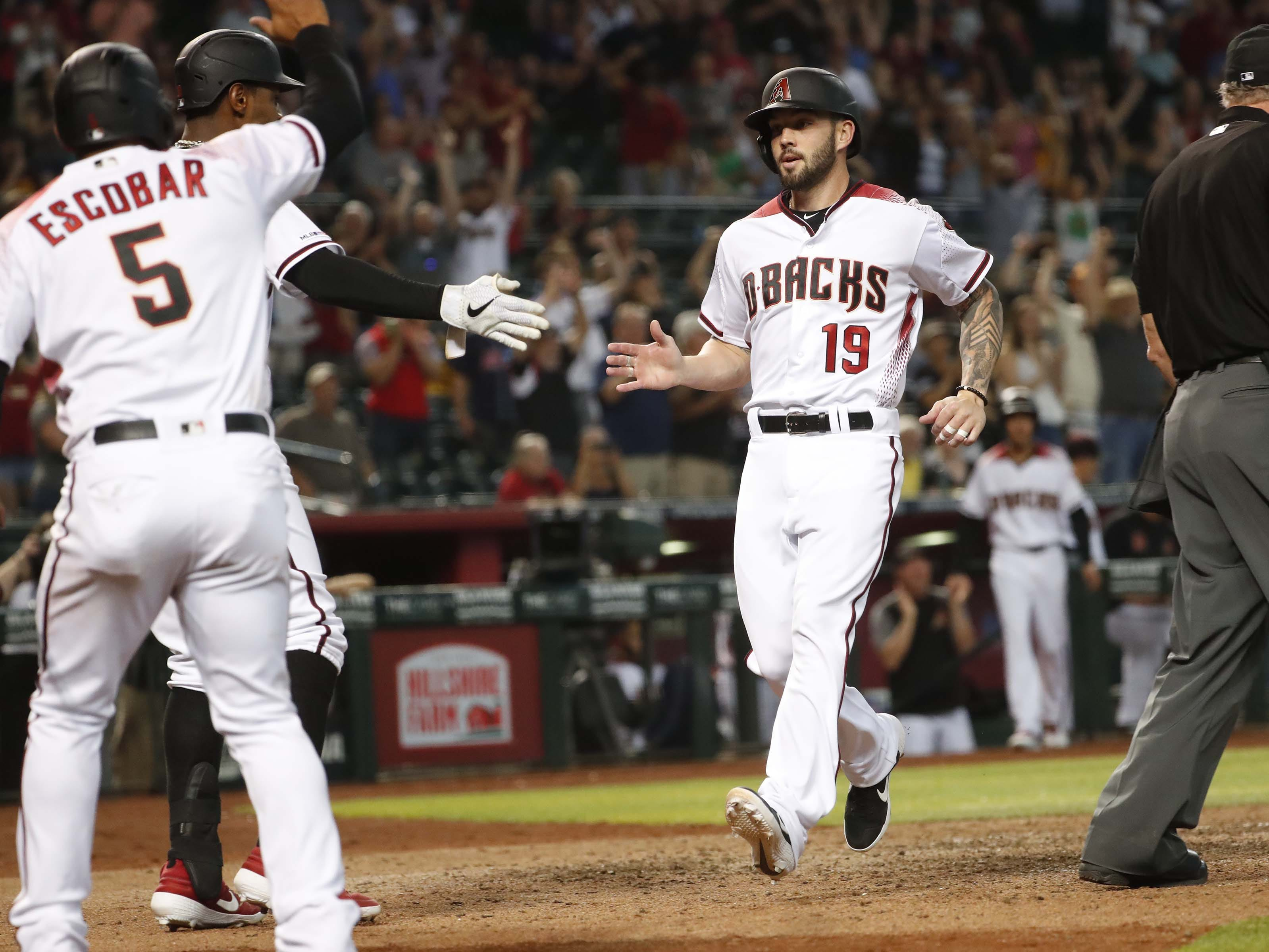 Arizona Diamondbacks' Blake Swihart (19) crosses home plate with an inside-the-park two-run home run against the Pittsburgh Pirates during the eighth inning at Chase Field in Phoenix, Ariz. May 15, 2019.