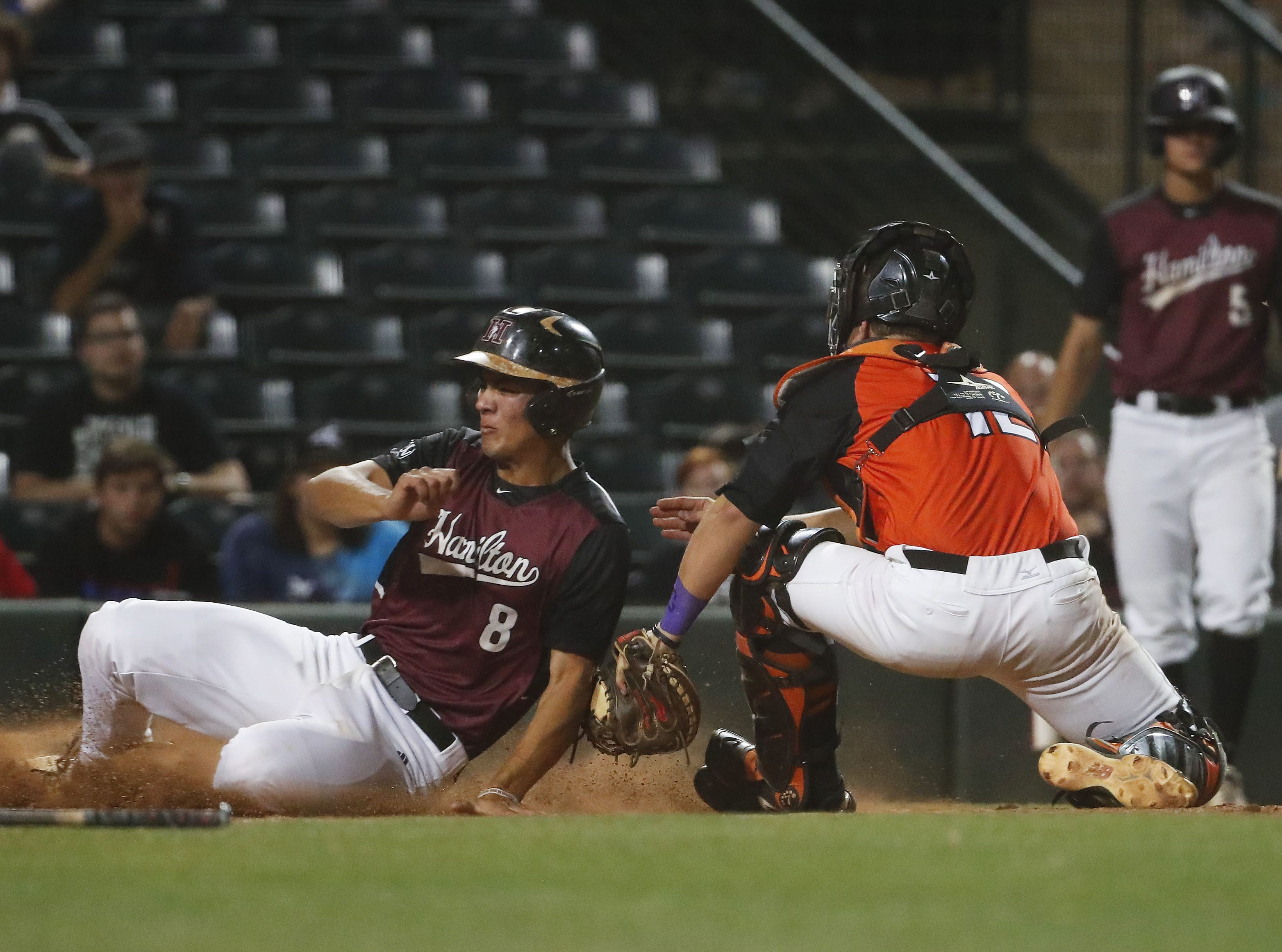 Hamilton first baseman Tyler Wilson (8) is tagged out at home by Corona del Sol catcher Ben Click (12) during the 6A State Baseball Championship in Tempe, Ariz. May 14, 2019.