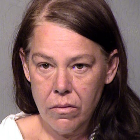 Records: Scottsdale woman told police she placed a bottle of gin on mother's body after smothering her