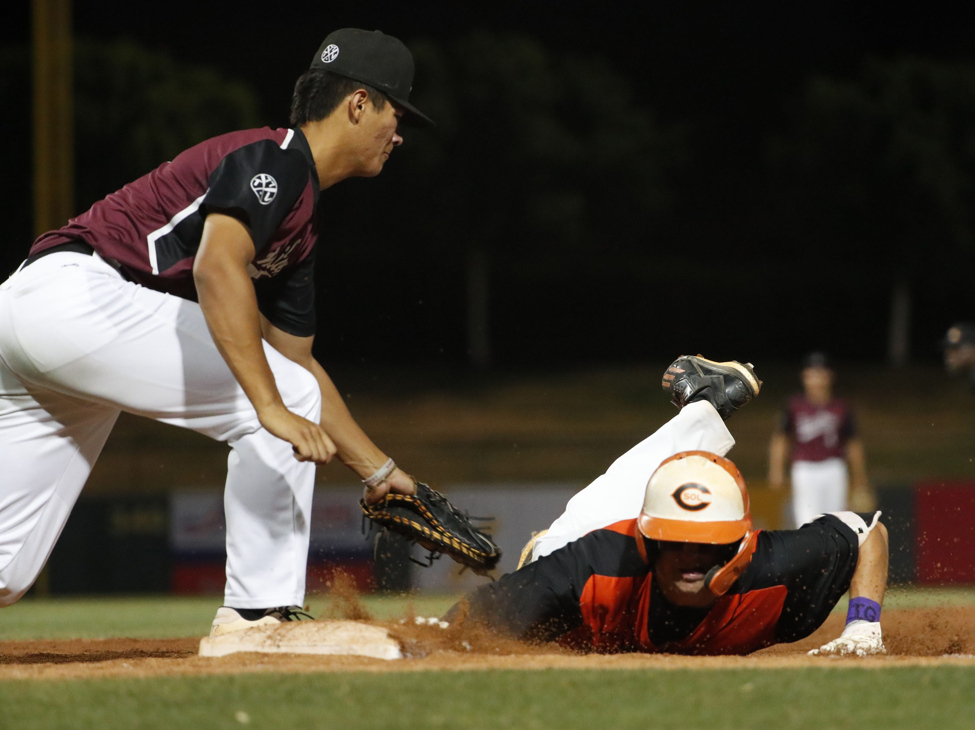 Corona del Sol shortstop Hunter Haas (7) dives back into to first ahead of the tag by Hamilton first baseman Tyler Wilson (8) during the 6A State Baseball Championship in Tempe, Ariz. May 14, 2019.
