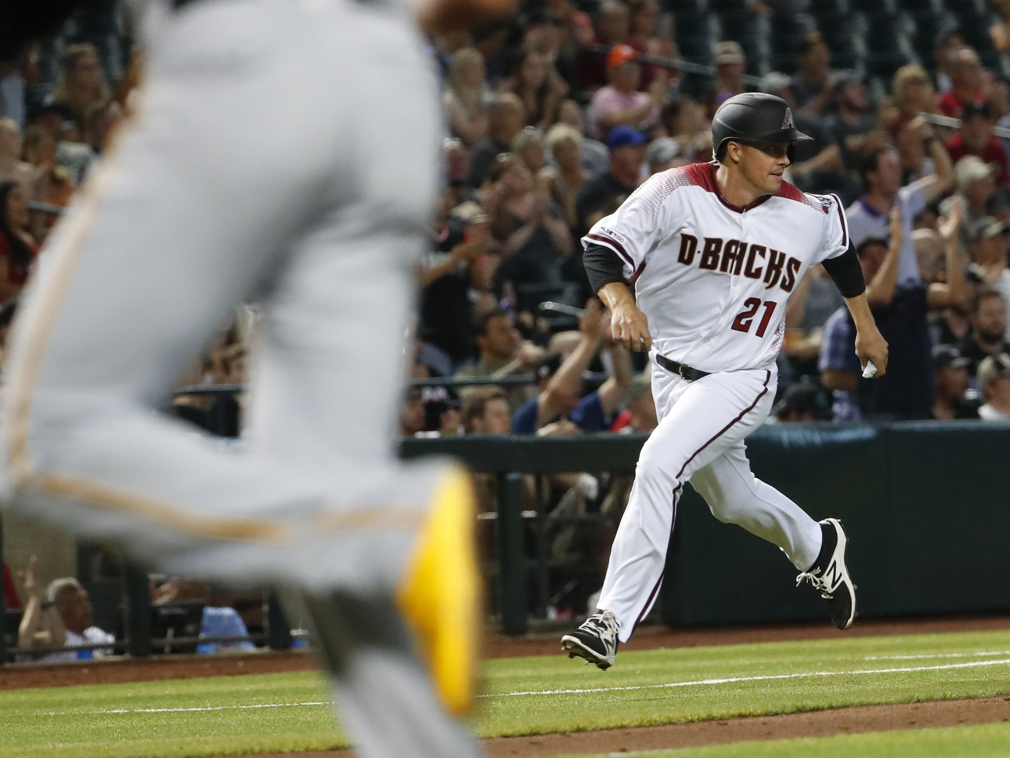 Arizona Diamondbacks starting pitcher Zack Greinke (21) rounds third base before scoring against the Pittsburgh Pirates during the fourth inning. at Chase Field in Phoenix, Ariz. May 15, 2019.