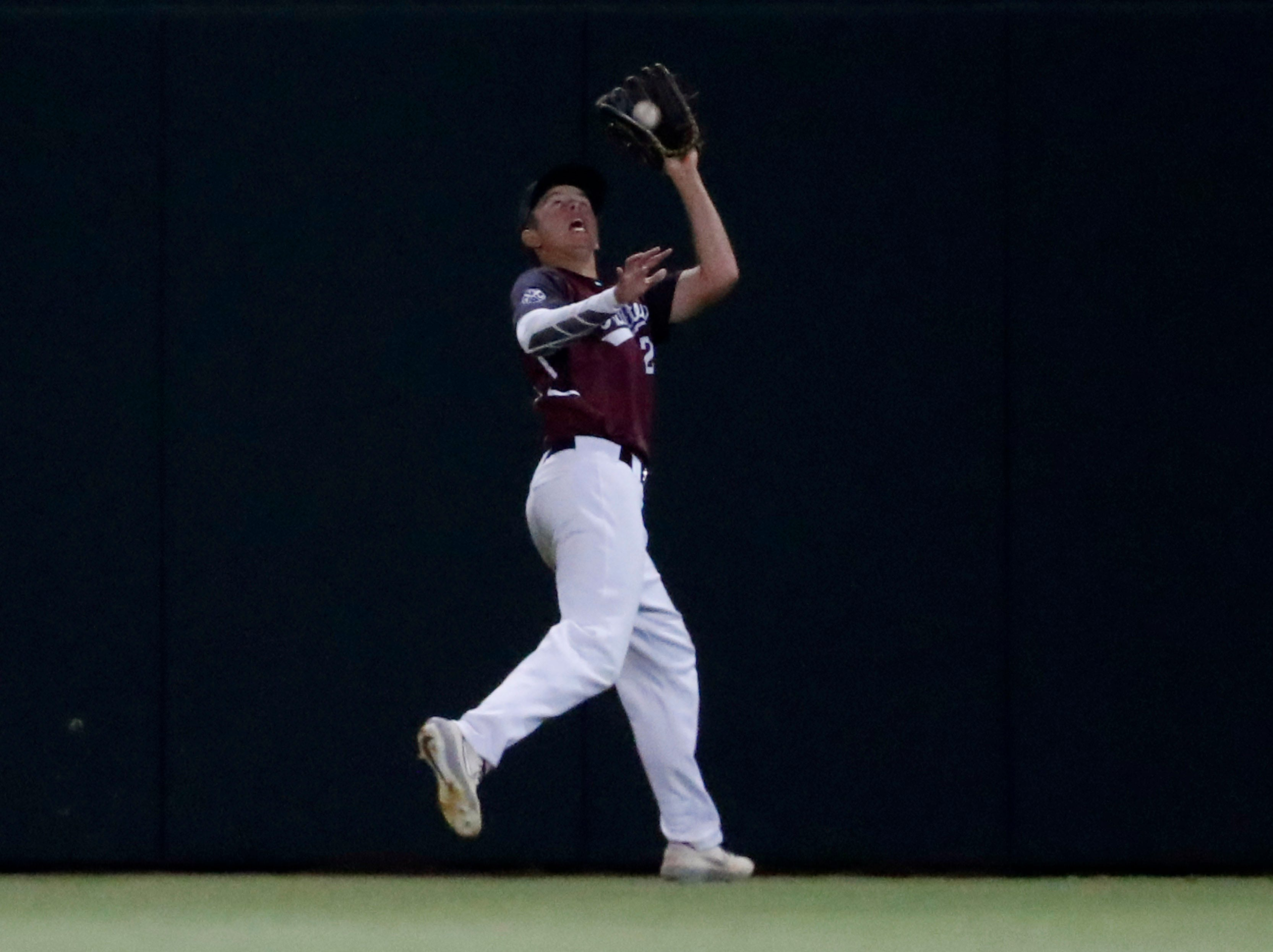 Hamilton center fielder Michael Brueser (22) catches a fly ball against Corona del Sol during the 6A State Baseball Championship in Tempe, Ariz. May 15, 2019.