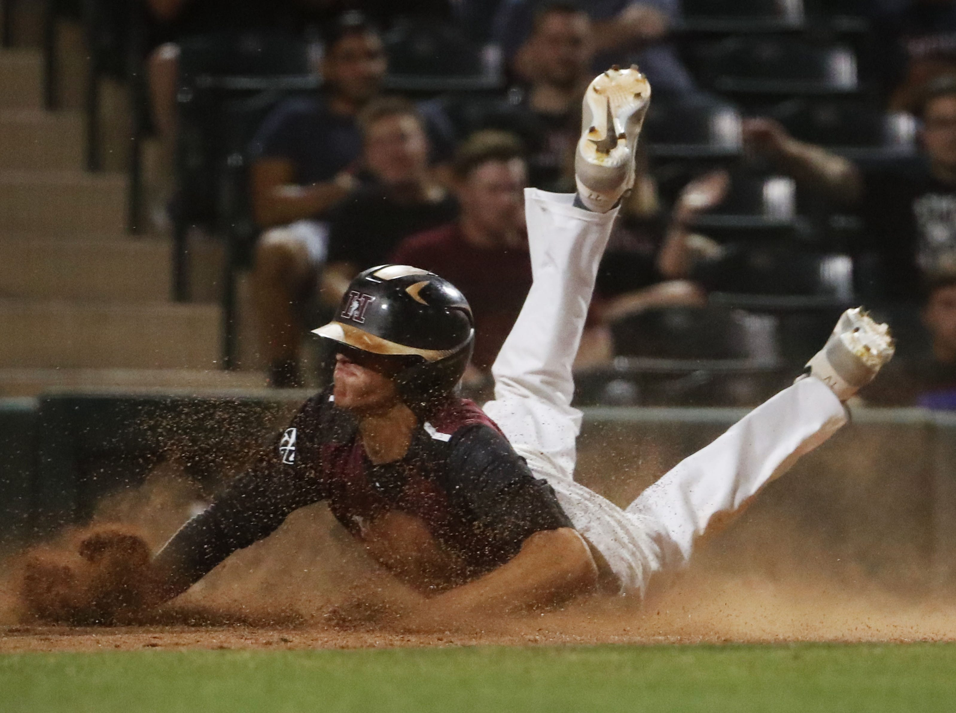 Hamilton right fielder JD Mclaughlin (23) scores against Corona del Sol during the 6A State Baseball Championship in Tempe, Ariz. May 14, 2019.