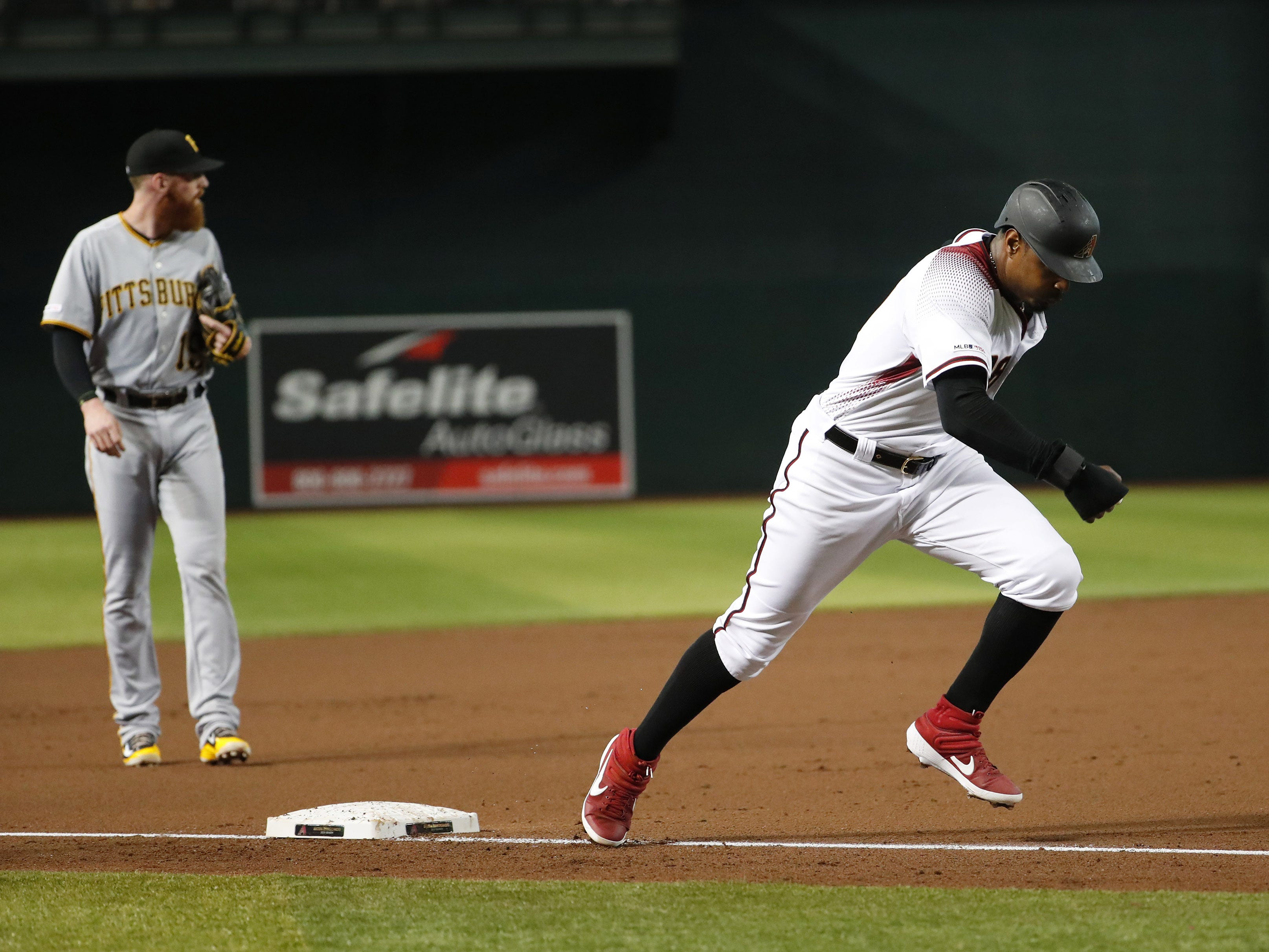 Arizona Diamondbacks right fielder Adam Jones (10) tags up from third base to score against the Pittsburgh Pirates during the first inning. at Chase Field in Phoenix, Ariz. May 15, 2019.
