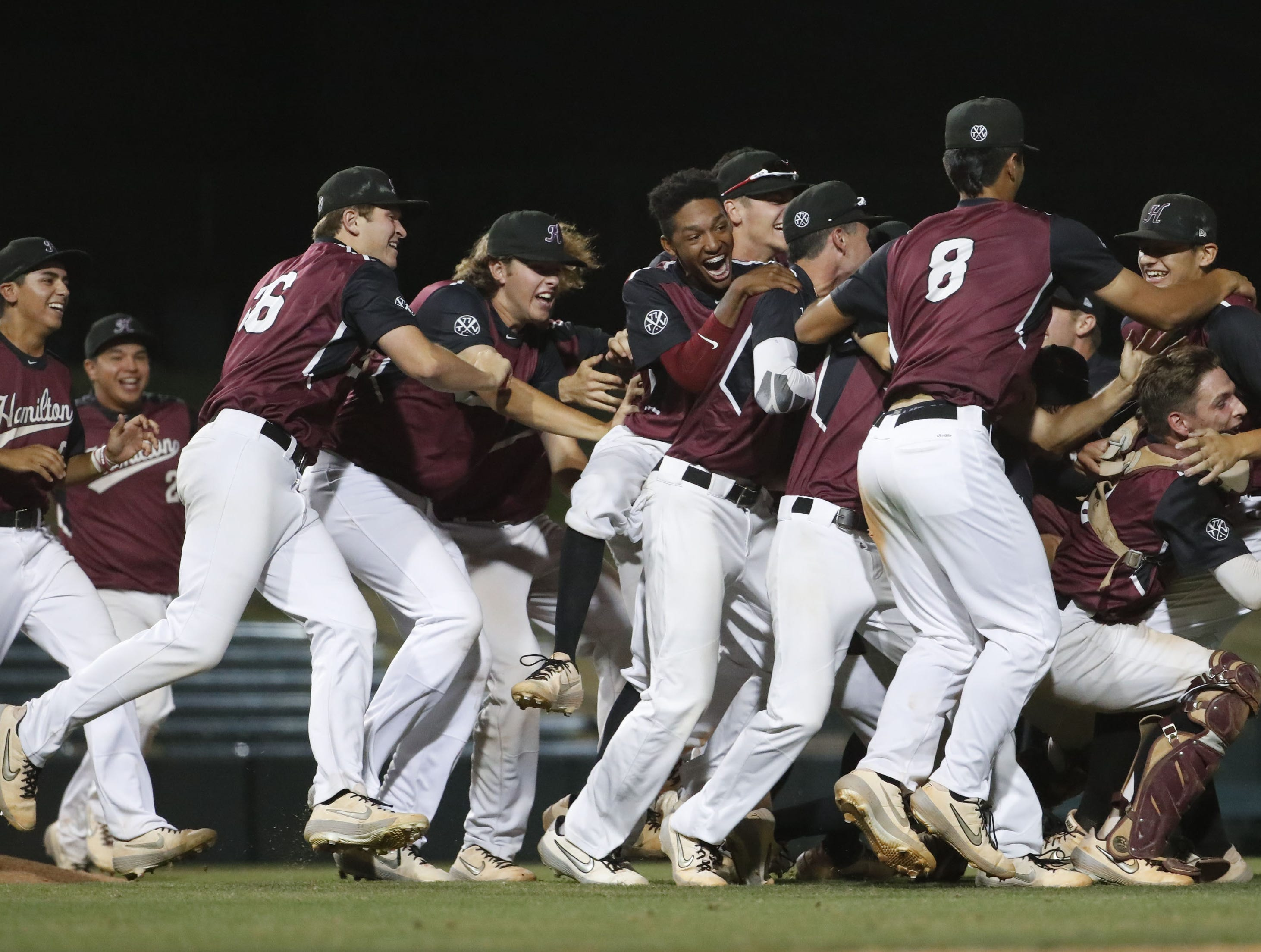 Hamilton players celebrate after beating Corona del Sol 8-1 to win the 6A State Baseball Championship in Tempe, Ariz. May 15, 2019.