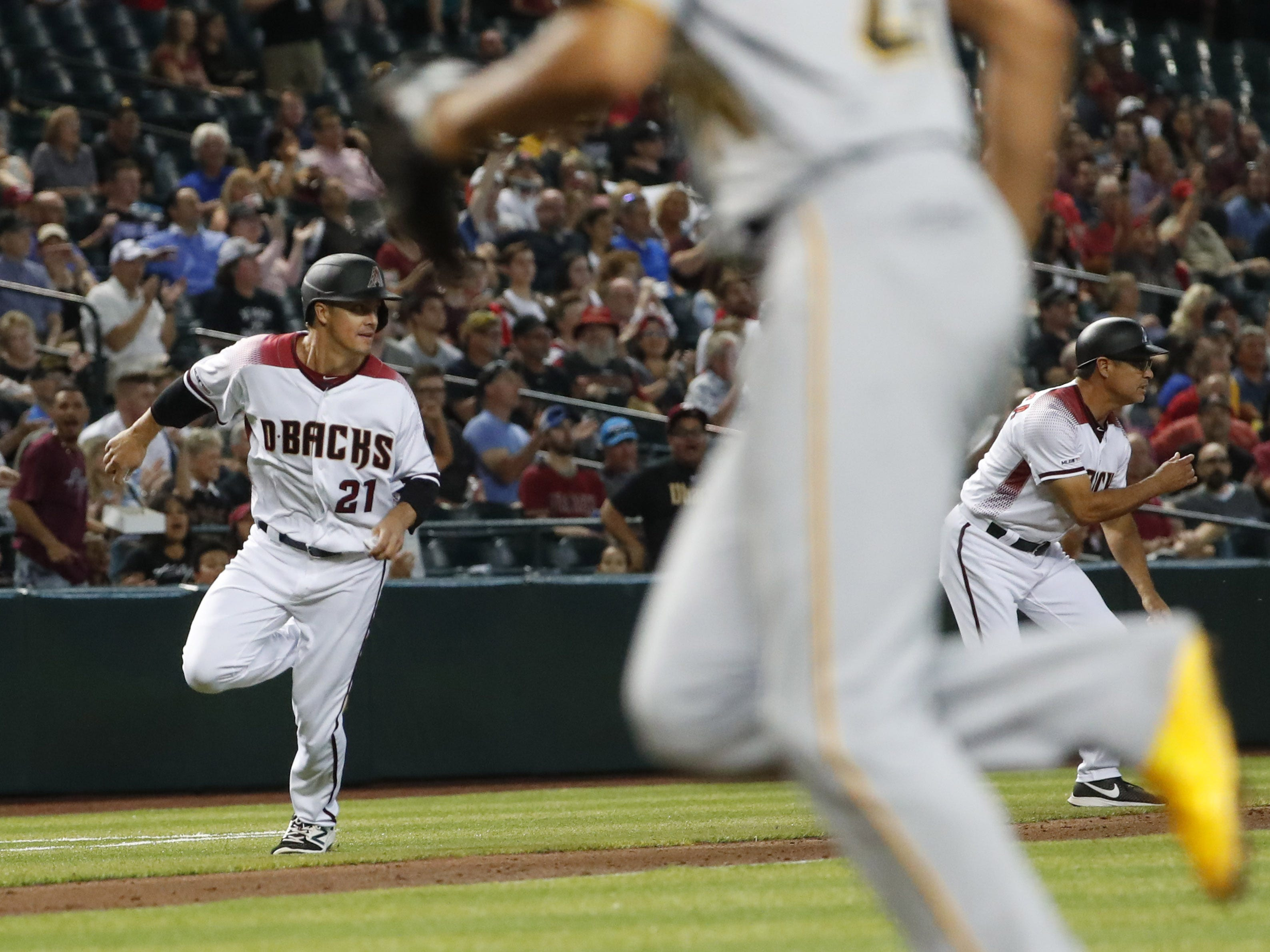 Arizona Diamondbacks' Zack Greinke (21) rounds third base before scoring against the Pittsburgh Pirates during the fourth inning. at Chase Field in Phoenix, Ariz. May 15, 2019.
