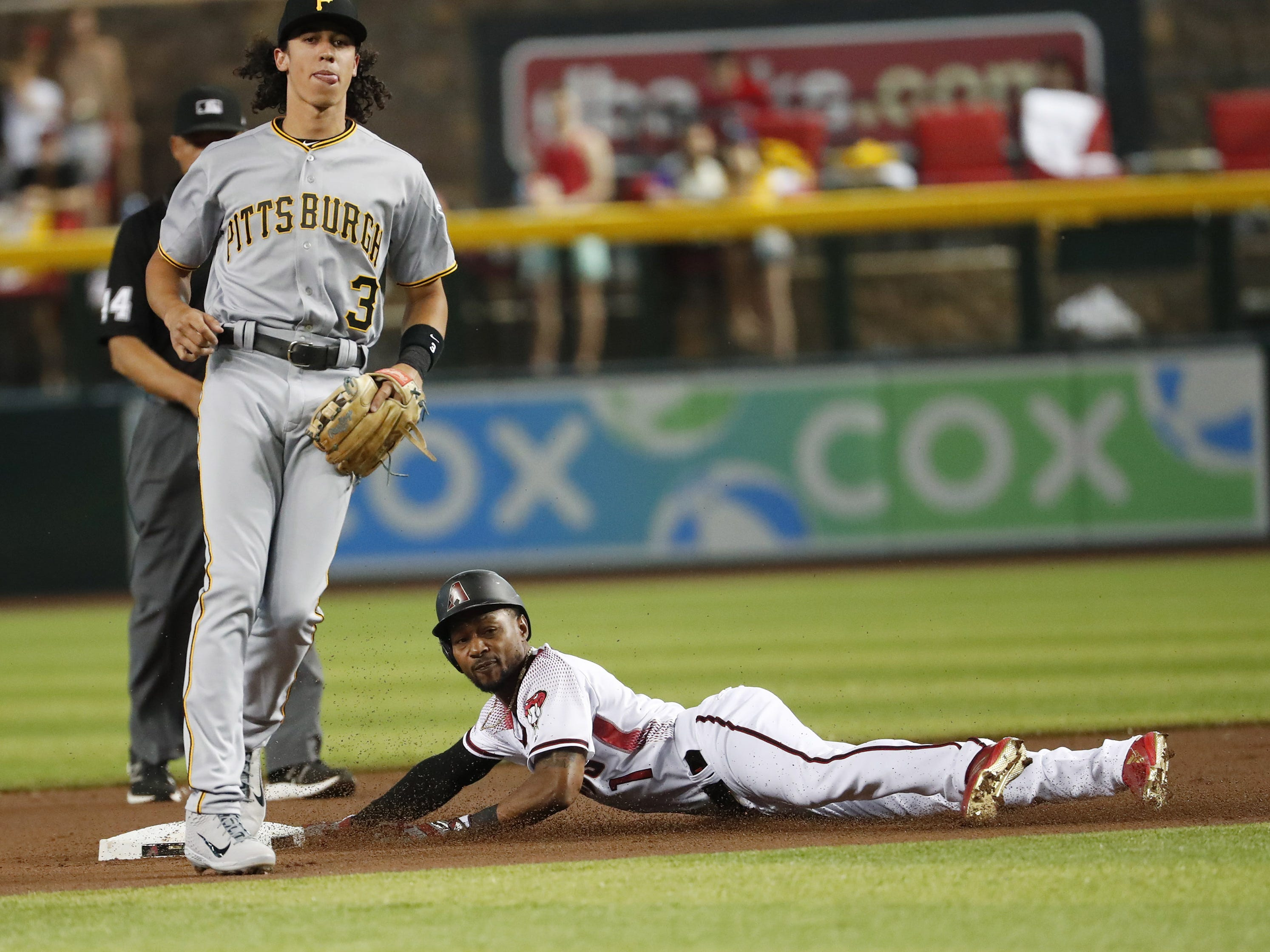 Arizona Diamondbacks center fielder Jarrod Dyson (1) steals second in front of Pittsburgh Pirates shortstop Cole Tucker (3) during the first inning. at Chase Field in Phoenix, Ariz. May 15, 2019.