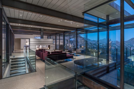 The $4.03M Paradise Valley home purchased by Richard Shawn Buckley and Andrea Parsek features walls of glass and mountain views.