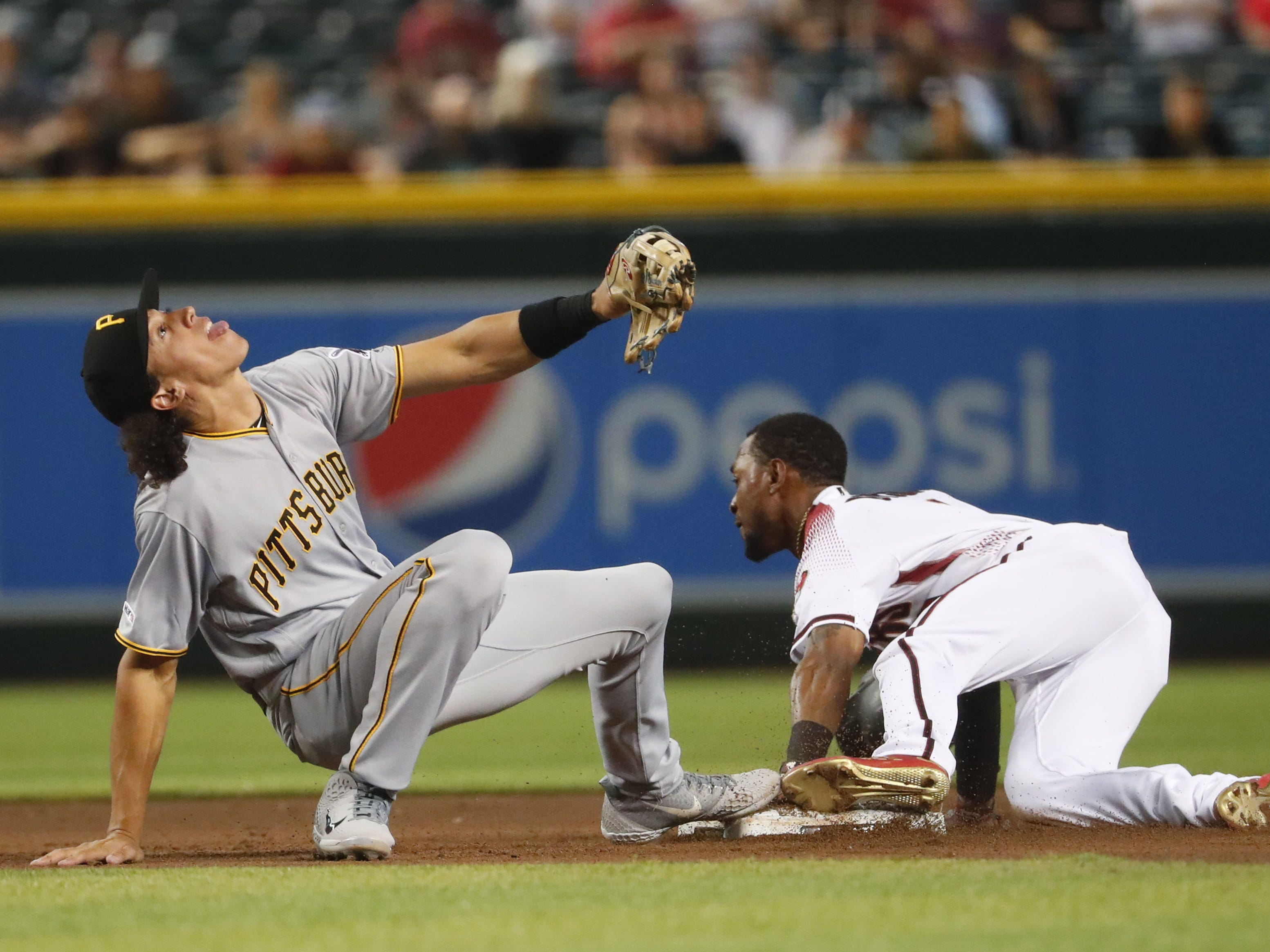 Arizona Diamondbacks center fielder Jarrod Dyson (1) steals second base as Pittsburgh Pirates shortstop Cole Tucker (3) looks for the ball during the fourth inning. at Chase Field in Phoenix, Ariz. May 15, 2019.