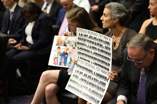 Nadia Milleron  holds a sign during the House Aviation Subcommittee hearing on the status of the Boeing 737 Max 8 on May 15, 2019. Milleron's daughter, Samya Stumo, was one of the people killed in the crash of Ethiopian Airlines Flight 302.