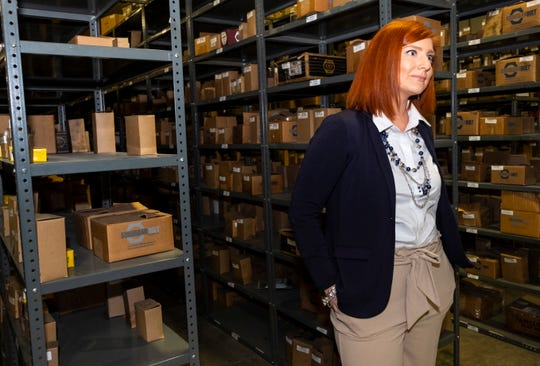 Nikki Gordon, Suburban Bolt and Supply Co. director of marketing, stands inside the company's warehouse Wednesday, May 15, 2019 in Port Huron.
