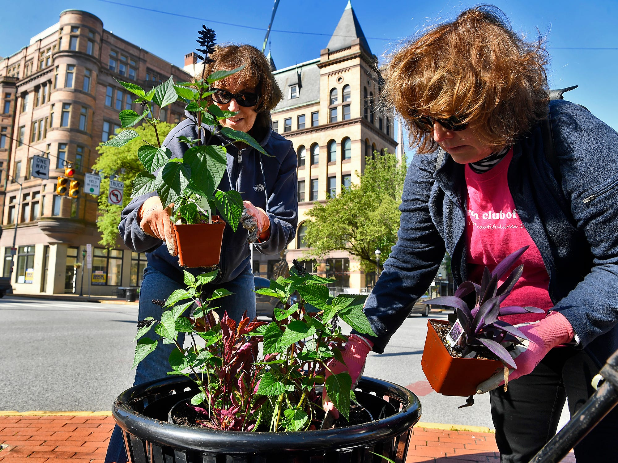 Chris Barkdoll, left of Dover, and Peggy Davidson of Spring Garden Township, help downtown York become a bit more colorful while planting containers with the Garden Club of York, Wednesday, May 15, 2019.John A. Pavoncello photo