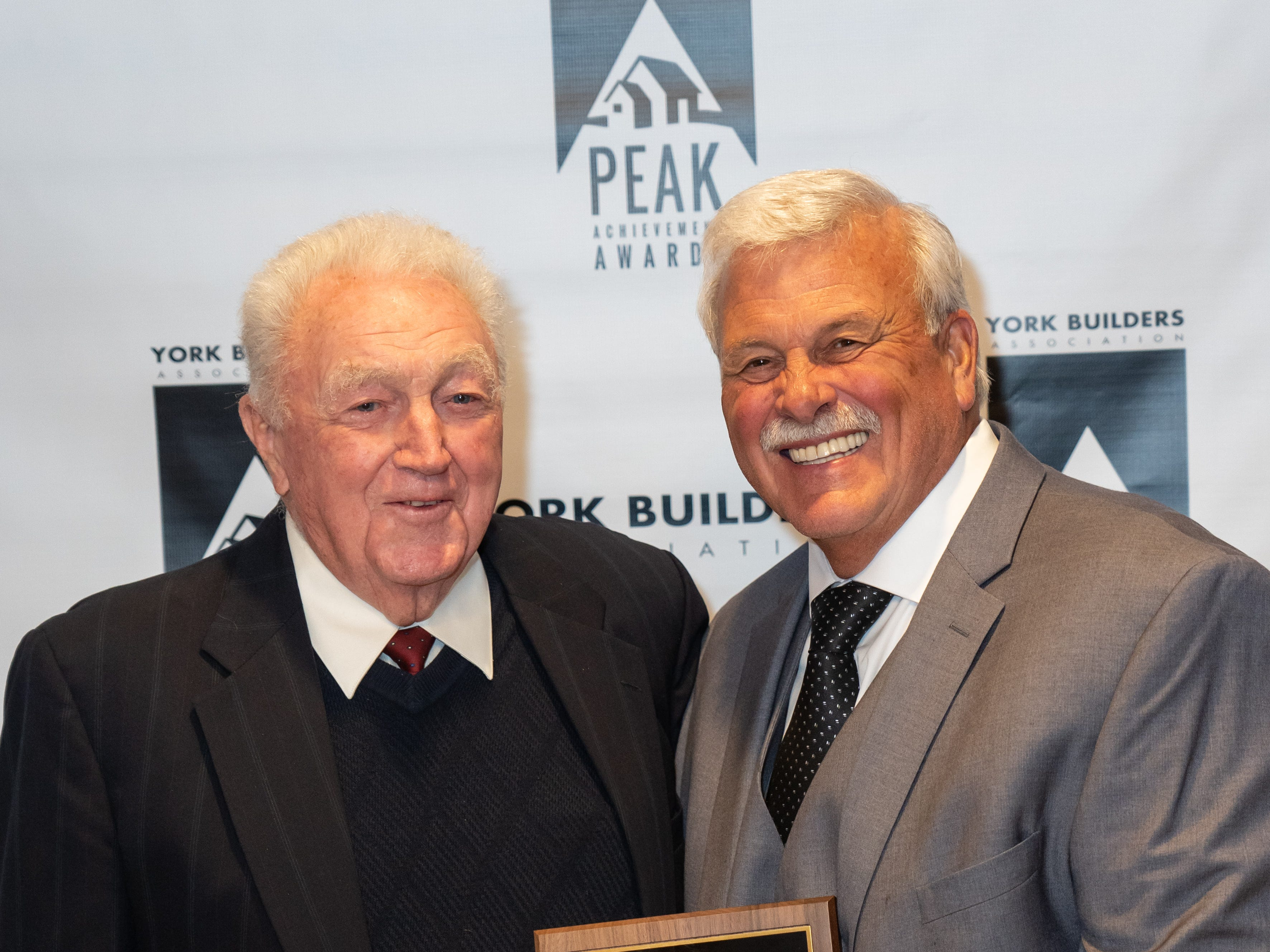 Mack Smith, left, presents Barry Strine, President of StrineÕs Heating & A/C, the 2019 Mack Smith Award from the York Builders Association (YBA). This award is part of the PEAK Achievement Awards, presented annually by YBA. The Mack Smith Award recognizes an individualÕs commitment to the goals and objectives of the Association and their contribution to the Association, the profession, and their community. submitted