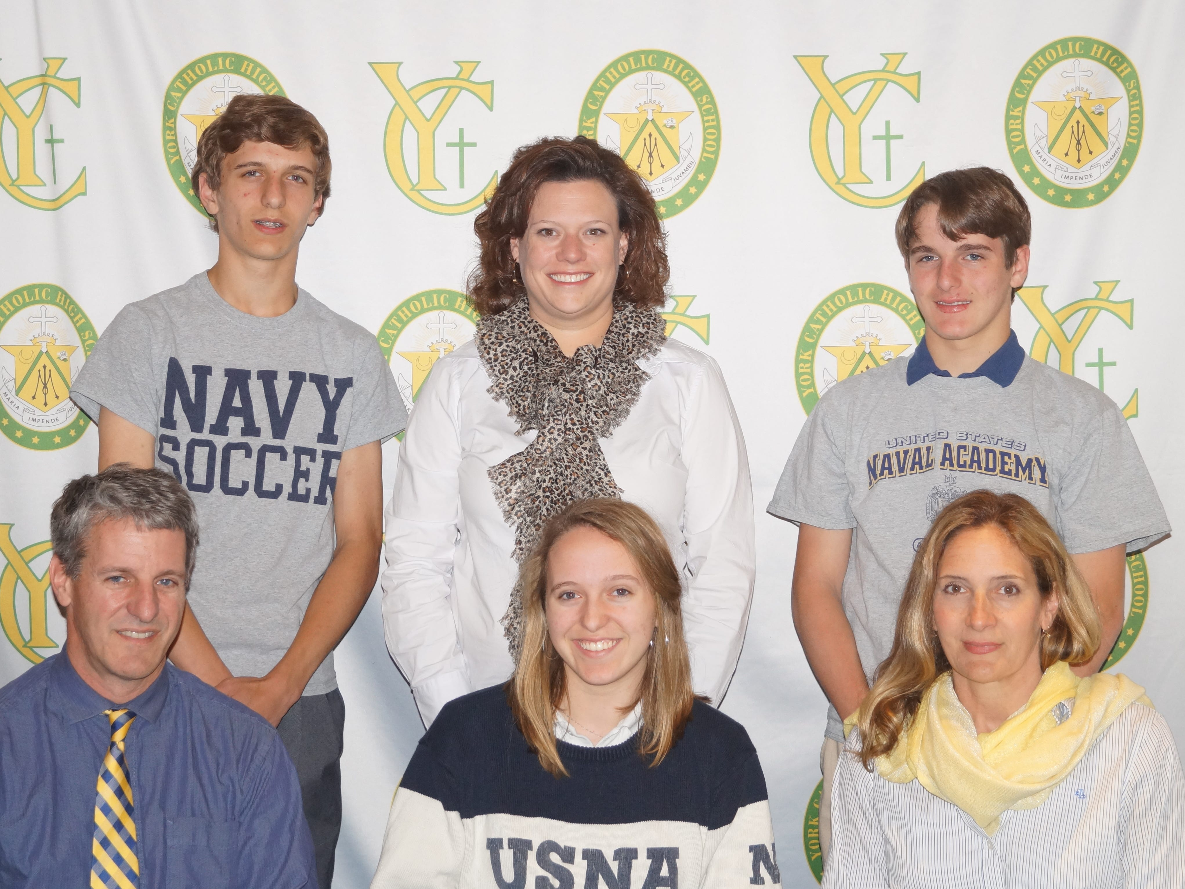 York Catholic High SchoolÕs Renee Bonner has committed to the United States Navy and will continue her education at Greystone Prep at Schreiner University in Kerrville, TX as a United States Naval Academy-sponsored student. Bonner received an award for perfect attendance during grades 7-12 at York Catholic. She is an honor roll student and took all honors and/or Advanced Placement courses her senior year.  She received an award for 50+ hours of service to the community each of her years from grades 7-11, and increased her hours to 100+ for her senior year.  She served as a volunteer with Shawnee Girl Scout Camp and Adopt-a-Highway, gave her time placing flags on veteransÕ gravestones, and was a student tutor and tour guide. Pictured are, front row from left: Kenneth Bonner, father of Renee; Renee Bonner; Diane Bonner, mother of Renee.  Back Row: Wesley Bonner, brother of Renee; Katie Seufert, York Catholic Principal, and Gavin Bonner, brother of Renee. submitted