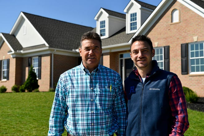 Jeffrey Henry, left, and son Justin are being recognized for sustainability and energy efficiency in building at the York Builders Association awards ceremony on Thursday. The featured home is located at 2716 Farnham Ln, York.