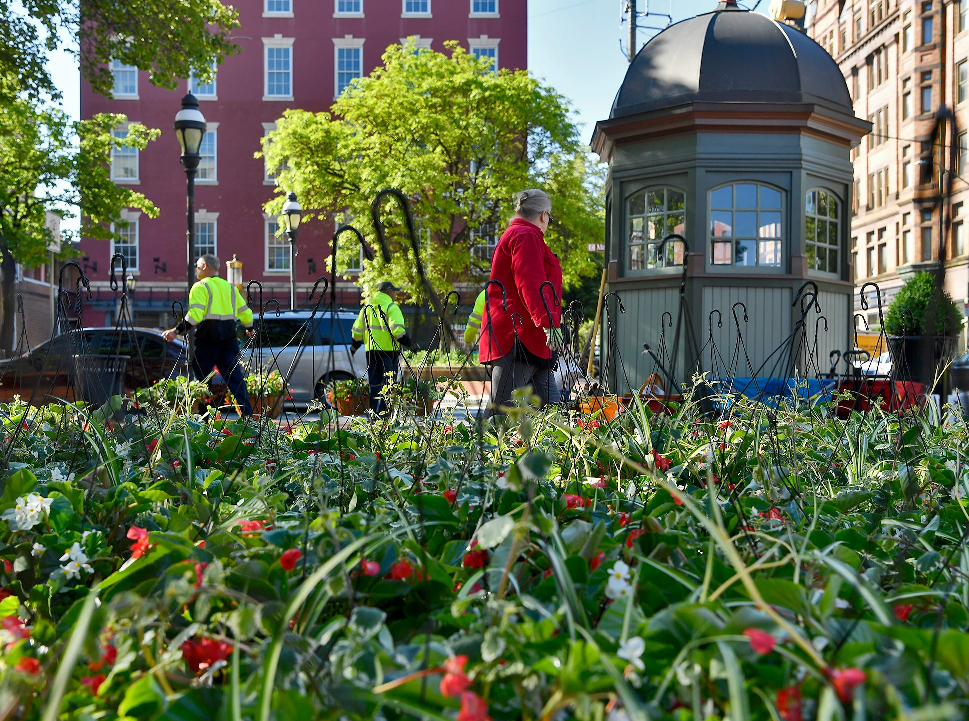 Downtown York becomes a bit more colorful as the Garden Club of York, along with Downtown Inc. and the City of York, fill planters and hang baskets of flowers, Wednesday, May 15, 2019.John A. Pavoncello photo