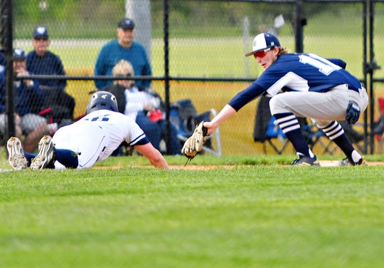 Dallastown's Darren Sciortino, right, catches the ball to get an out on West York's Gabe Allen at third base during York-Adams League baseball semifinal action at Spring Grove High School on Wednesday, May 15. Dallastown would win the game 12-0. The Wildcats are the No. 2 seed in the upcoming District 3 Class 6-A playoffs. Dawn J. Sagert photo