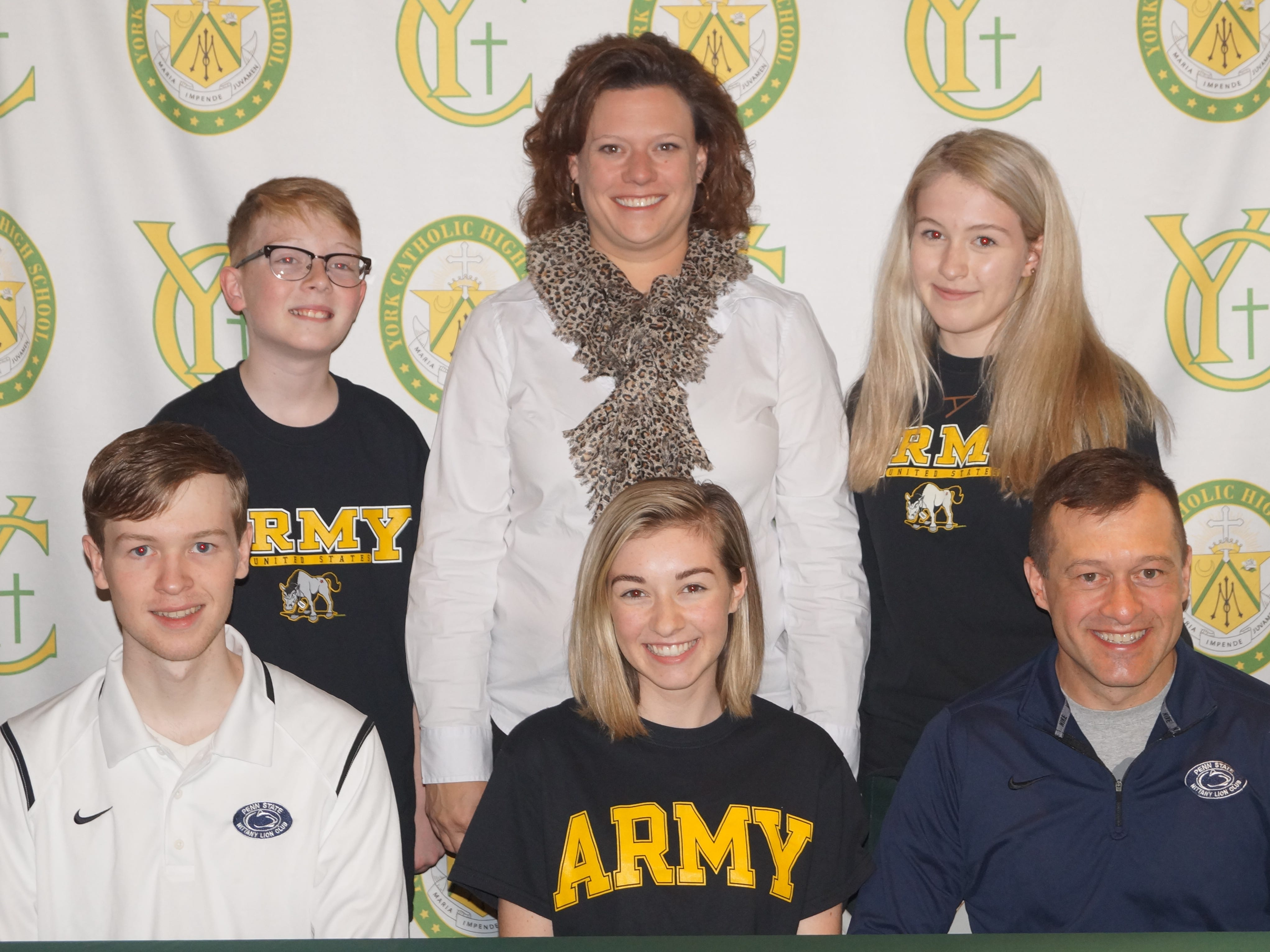 York Catholic High SchoolÕs Megan Hale has committed to the United States Army Reserve Officer Training Corps (ROTC) while continuing her education at Penn State University in University Park, PA. Hale is an Honor Roll student and a member of the National Honor Society.  She is also a member of the Cross Country team, Varsity Club, Spanish Club, Musical, Students Against Destructive Decisions, and is a Eucharistic Minister. While at York Catholic, she has received honors for maintaining a 93% or higher in all of her classes and for maintaining the highest average in Honors Chemistry.  Pictured are, front row from left: Trevor Hale, MeganÕs brother; Megan Hale; Jim Hale, father of Megan. Back Row:  Ryan Hale, MeganÕs brother; Katie Seufert, York Catholic Principal; Anna Hale, MeganÕs sister. submitted