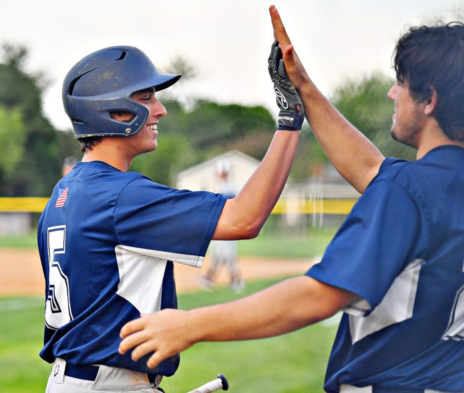 Dallastown's Jase Graybill, left, and Peter Capobianco celebrate a run during baseball semifinal action at Spring Grove Area High School in Jackson Township, Wednesday, May 15, 2019. Dallastown would win the game 12-0. Dawn J. Sagert photo