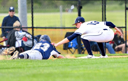 West York's Corey Wise, right, tags out Dallastown's Evan Beach at third during baseball semifinal action at Spring Grove Area High School in Jackson Township, Wednesday, May 15, 2019. Dallastown would win the game 12-0. Dawn J. Sagert photo